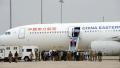 老挝向中国移交104名电信诈骗犯罪嫌疑人