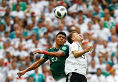 Mexico stun champions Germany 1-0 in opener