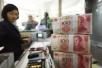 人民币对美元缓步走高,中金称中国不会率先放手人民币贬值