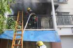 湖州一小区二楼大火致2名女童被困,邻居男青年爬楼砸窗救人