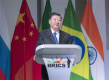 Xi urges liberal global trade system